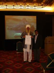 Guru Dev Singh accepting award with Dr. Harsha Jayatalake.